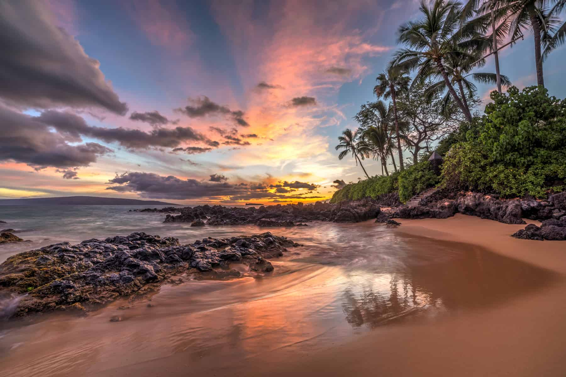 sunset in a secret cove in Maui, Hawaii - Partenza Travel creates luxury Hawaii vacation packages